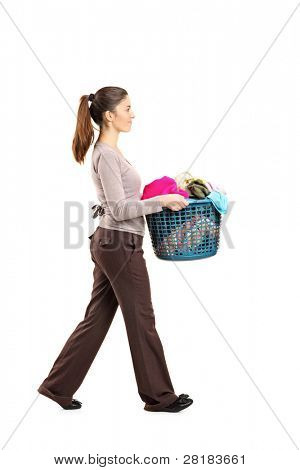 Full length portrait of a female holding a laundry basket isolated on white background