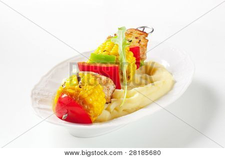 Potatoes puree with meat skewer and vegetables