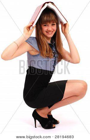 Girl Holds The Book On A Head