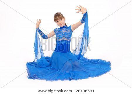 Girl In Blue Dress Posing In Studio