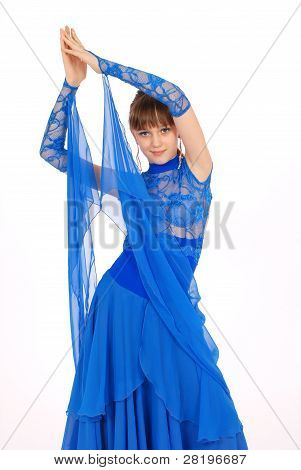 Girl In Blue Dress Posing In Studio