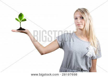 Eco Concept: Beautiful Woman With Green Plant In Her Palm