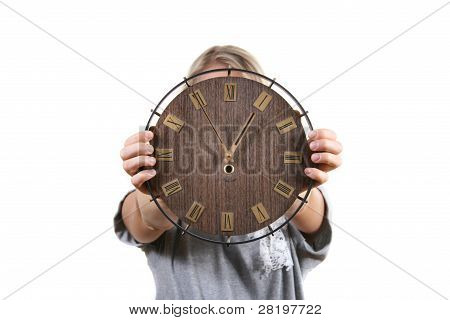 Woman Holding Clock In Front