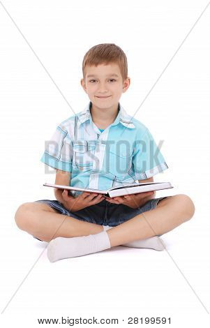 The Young Boy Sits Near The Open Book