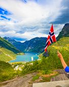 Norwegian Flag And Beautiful View Over Geirangerfjorden From Flydalsjuvet Viewing Point. Tourist Att poster