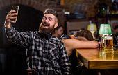 Taking Selfie Concept. Online Communication. Send Selfie To Friends Social Networks. Man In Bar Drin poster