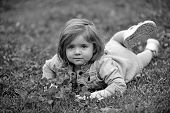 Little Girl Relax On Spring Or Summer Day Outdoor. Cute Child Lie On Green Grass Lawn. New Life, You poster