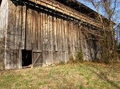 stock photo of tobacco barn  - 1940 built tobacco barn on a beautiful sunny early spring afternoon - JPG