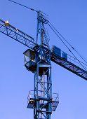 Tower Crane Against A Blue Sky poster