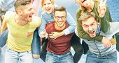 Group Of Friends Having Fun In A Underground Station - Men Piggybacking Their Girlfriends - Young Pe poster