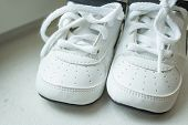 Pair Of White Sport Sneaker Shoes On White Background.baby Sneakers, Running Shoes.children Shoes. M poster