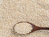 Grain Of Quinoa. Uncooked Raw Quinoa As Background. Top View Of Quinoa With Grains In Wooden Spoon.  poster