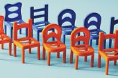 Red And Blue Chairs Standing In Two Rows On A Blue Background, First Row Red Second Row Blue, Toy Ch poster