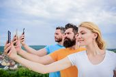 Sharing Selfie On Social Network. Best Friends Taking Selfie With Camera Phone. Pretty Woman And Men poster