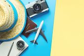 Travel Accessories Objects And Gadgets Top View Flatlay On Blue Yellow poster