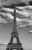 Eiffel Tower Also Called Tour Eiffel In French Language With Black And White Effect And Many Clouds poster