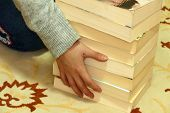 Thick Books And A Person Wanting To Carry Books, A Human Hand Touching The Thick Book, Thick Novel B poster