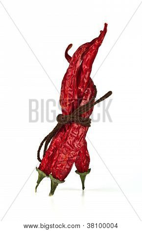 Three Dried Red Chili Peppers