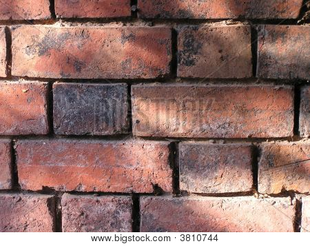 Dappled Sunshine On Old Bricks