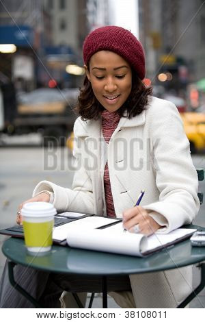 Woman Jotting Down Notes