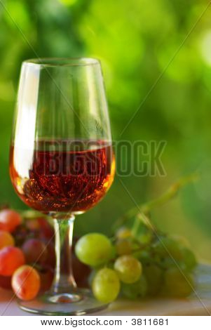 Glass And Grapes Of Rosé  Wine