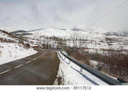 Wet Road In A Snowy Mountain