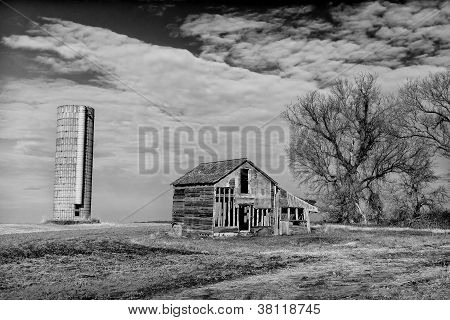 Abandoned Farmhouse And Silo In Black And White