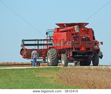 Farmer And Combine