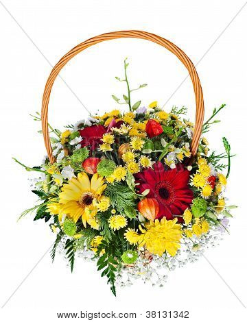 Colorful Flower Bouquet Arrangement Centerpiece In A Wicker Gift Basket Isolated On White Background