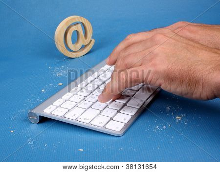 A Man Writes On Pc Keyboard  With Cookies Tracks