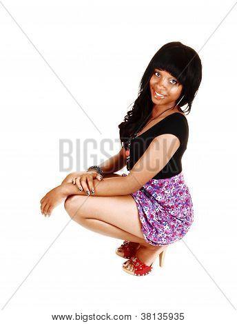 Crouching Girl On Floor.
