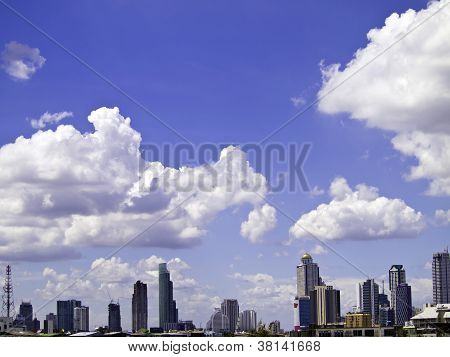 Blue Sky With Cloud, A City With Tall Buildings