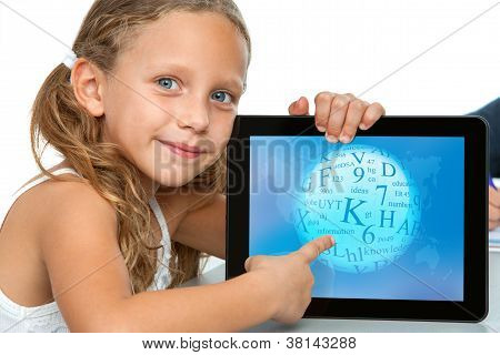 Close Up Of Cute Girl Pointing On Tablet.