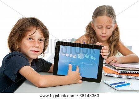 Cute Boy Student Doing Maths On Digital Tablet.
