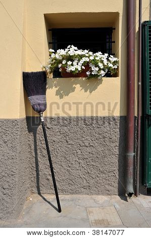 Broom Propped Against The Wall