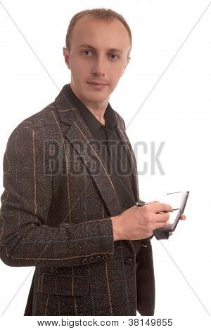 Portrait Of A Caucasian Young Man Making Notes