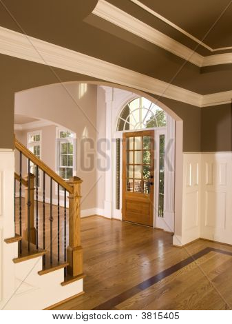 Luxury Home Entranceway With Arch Window