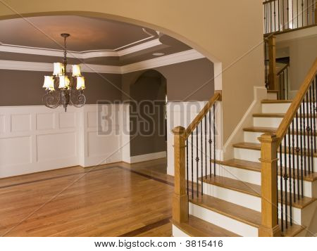 Luxury Home Entranceway With Descending Staircase