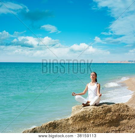 Woman Doing Yoga near the Sea