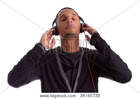 Young Black Man With Closed Eyes Listening To Music