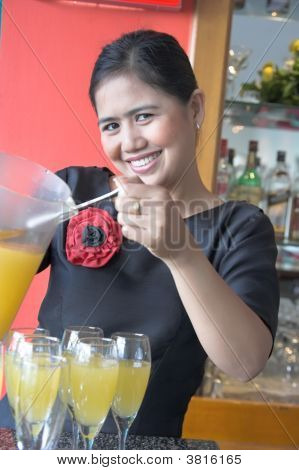 The Waitress Making Drink Smiling