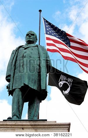 Statue with USA and MIA-POW Flags