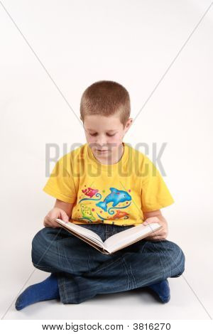 Boy And Schoolbook