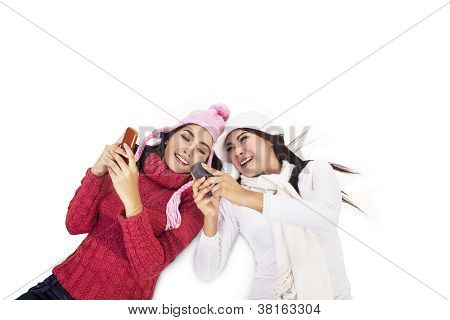 Young Women Playing Mobile Phone