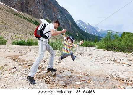 Father And His Son Hiking