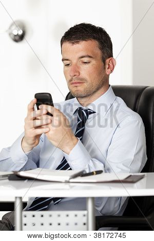 Man Reading A Message