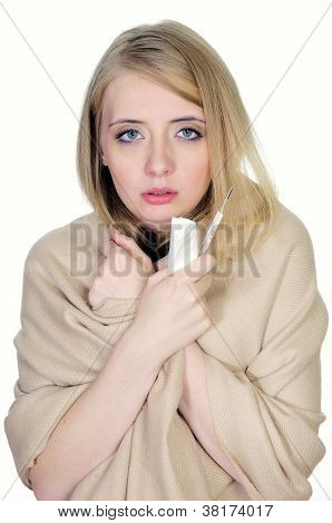 Woman with flue holding thermometer and handkerchiefs