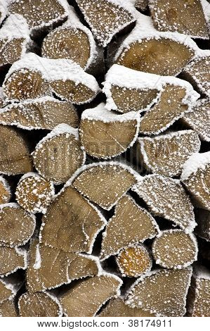 Stack of cut firewood in the snow
