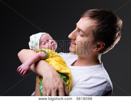Happy Young Father And Newborn Girl