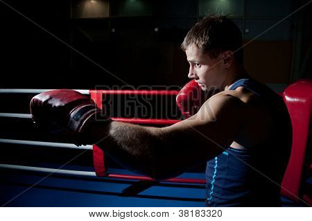 Man Fighting On The Ring